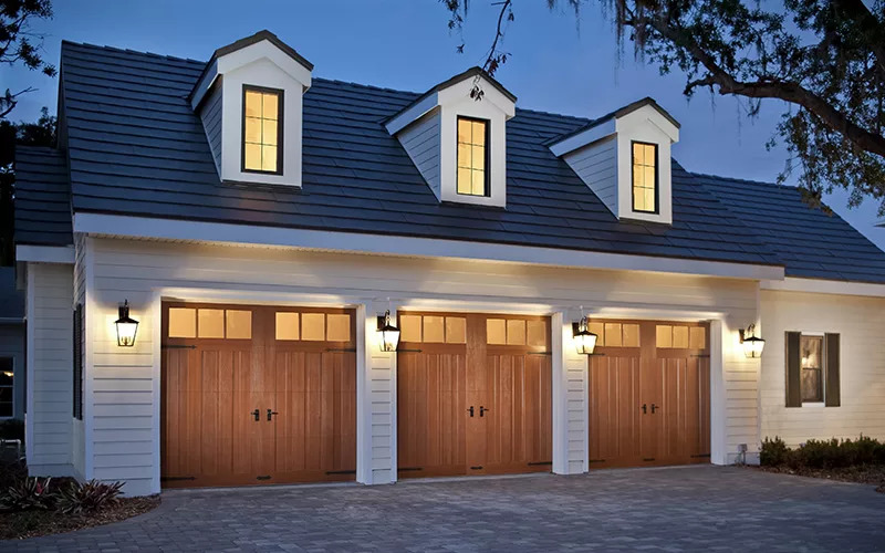 Home with three Canyon Ridge carriage house style garage doors