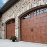 Home with two rustic faux wood Gallery Collection garage doors