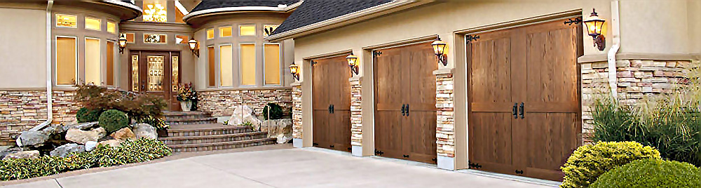 House with three wood Canyon Ride Carriage House garage doors