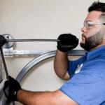 Broten Garage Door Sales technician repairing a garage door