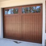 Wooden garage door with windows across the top