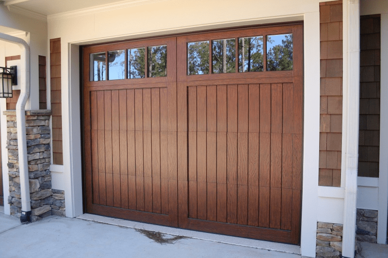 Wooden garage door with windows across the top