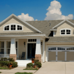 Home with tan two-car Coachman Collection garage door