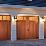Home with three full width Canyon Ridge Limited Edition Series carriage house garage doors