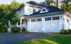 Thumbnail of House with two white steel carriage house style garage doors