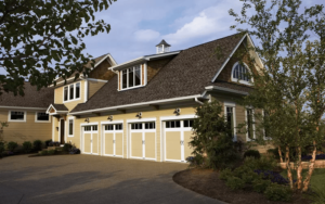 Thumbnail of Home with four premium Coachman Collection garage doors