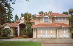 Thumbnail of Home with tan two-car Coachman Collection garage door
