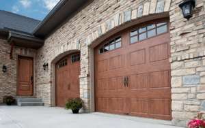 Thumbnail of Home with two rustic faux wood Gallery Collection garage doors