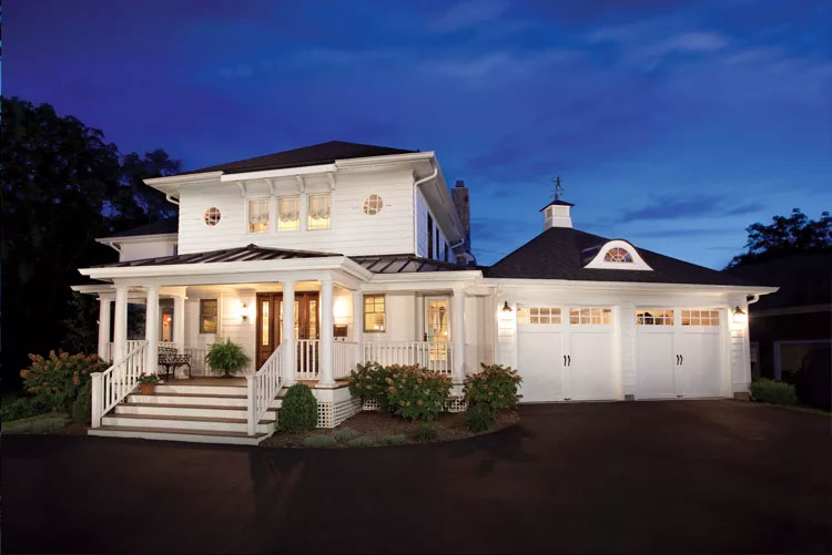 Home with two white, single-car Coachman Collection garage doors