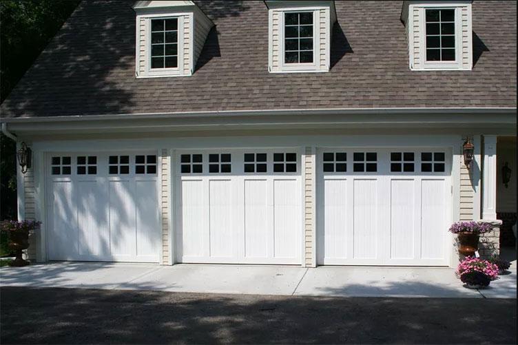 Home with three white Eden Coast garage doors
