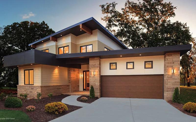 Home with brown Modern Steel Series garage door