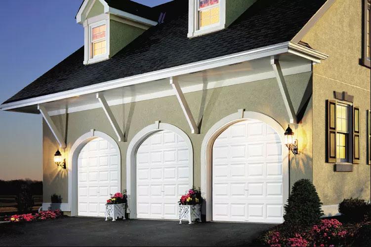 Home with three white premium series garage doors